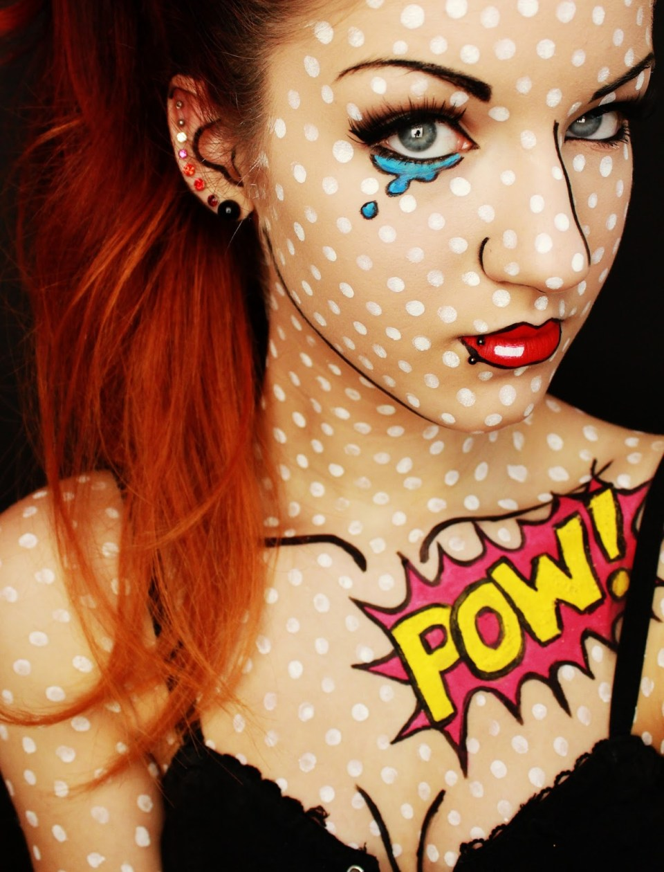 Girl with makeup for halloween as pop art