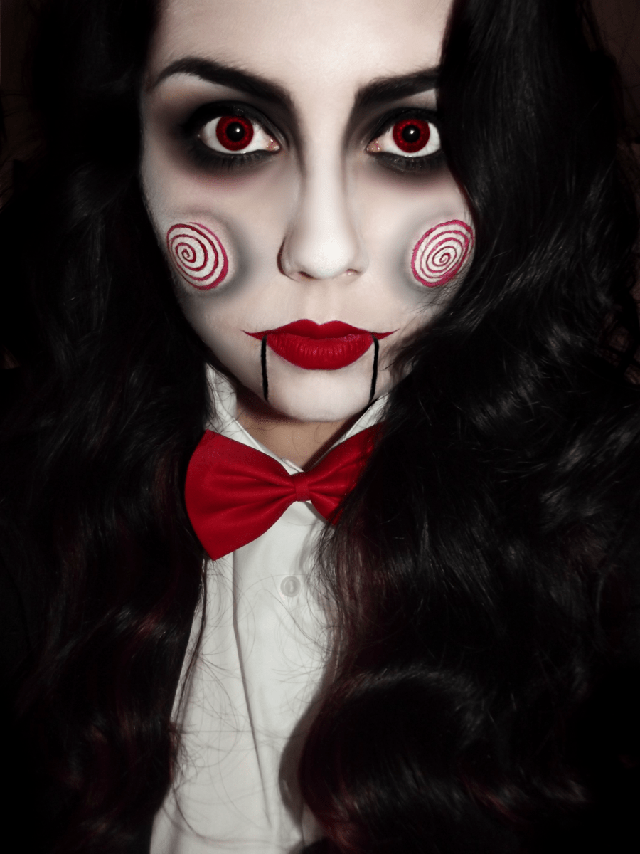 Girl with makeup for halloween as saw
