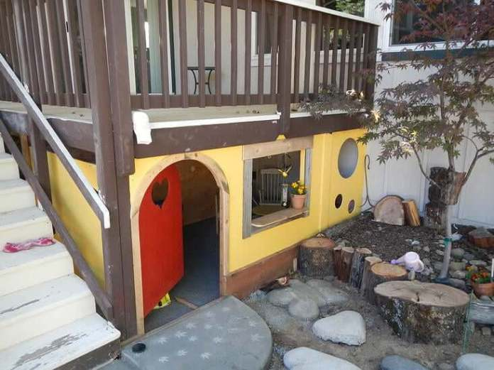 A Backyard with a Playhouse under the Deck