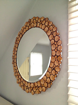 Circular mirror with wood slide