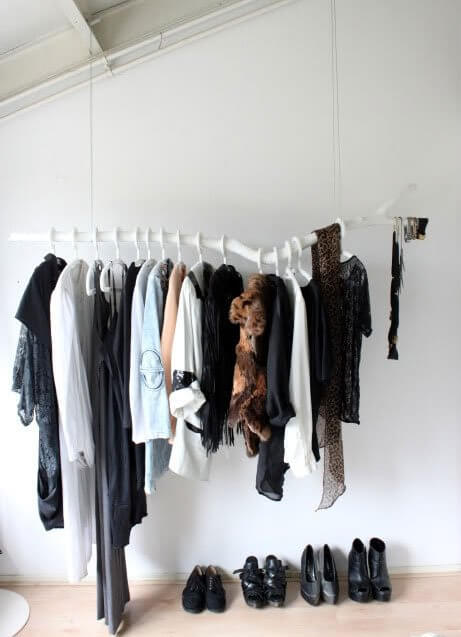 Tree branch clothes rack