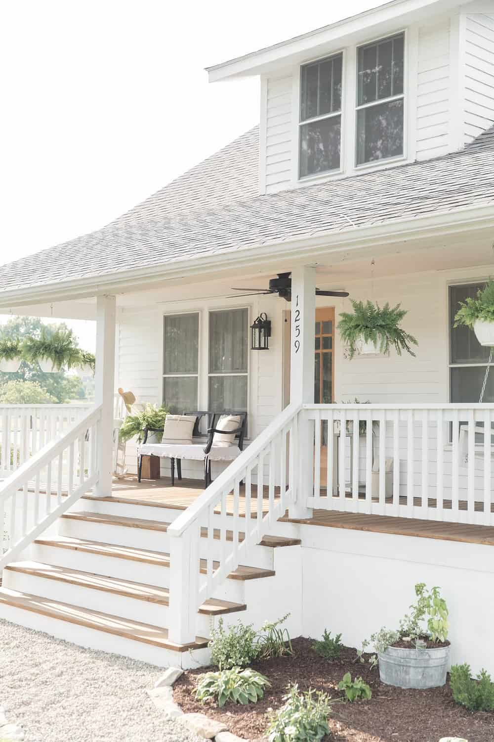 Farmhouse porch curb appeal makeover reveal farmhouse on for Farmhouse front porch pictures
