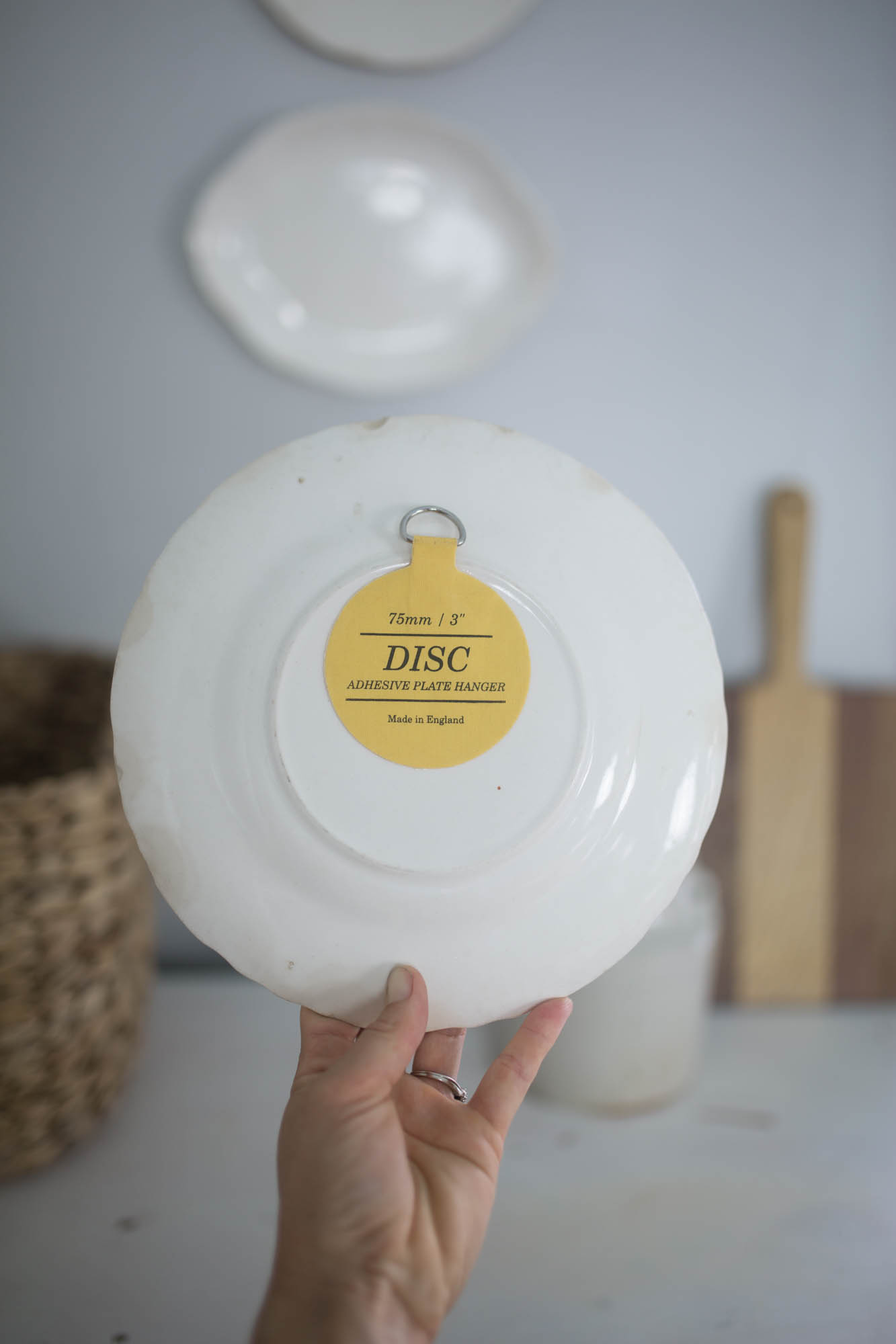 How to Hang Plates on a Wall Using Adhesive Plate Discs