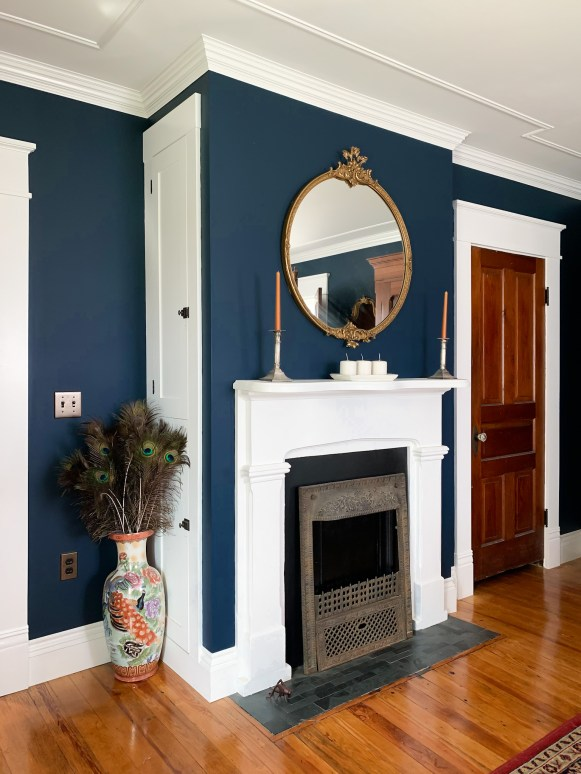 navy bedroom fireplace with white trim