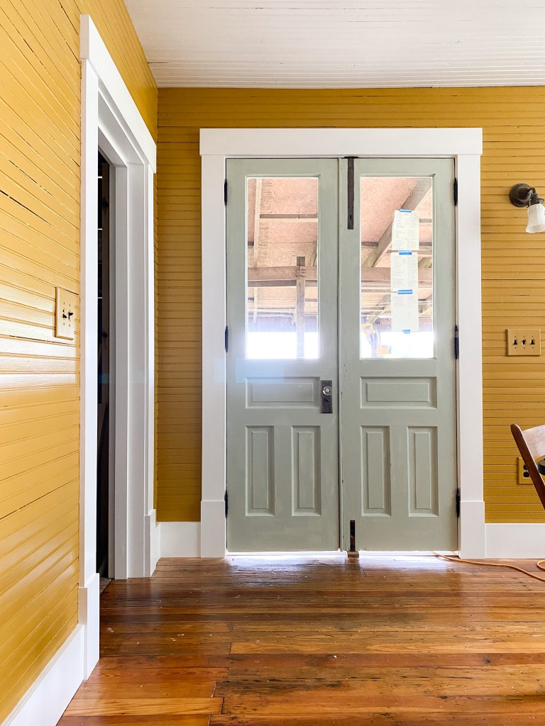 green double doors yellow walls