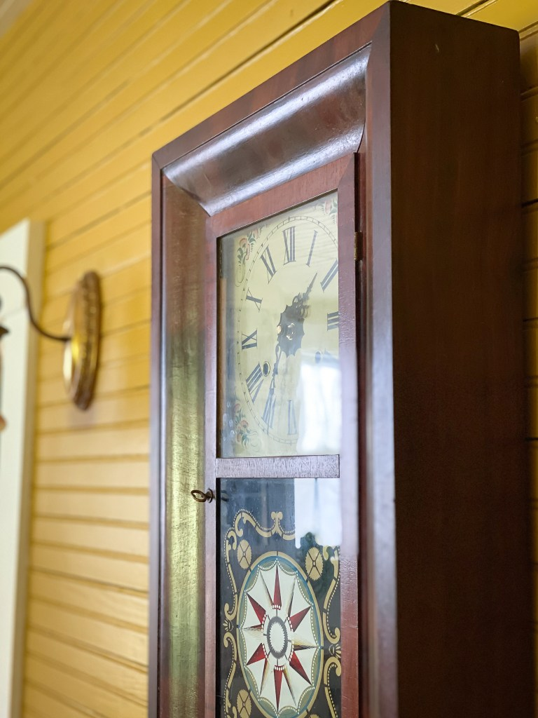antique clock yellow wall