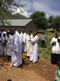 Priests wearing Christian and Marakwet attire