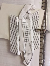 paper craft- Phoenician ship- flattened with a rolling pin and placed in binder