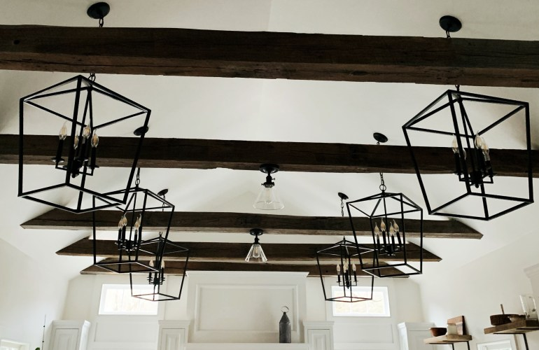 Find out why these black iron cage lights were selected for a farmhouse kitchen.