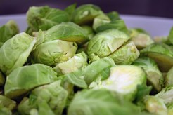 Wash and pull top layers off Brussels sprouts and cut in halves