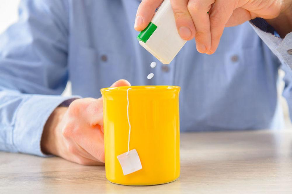 Stevia drops being added to hot tea