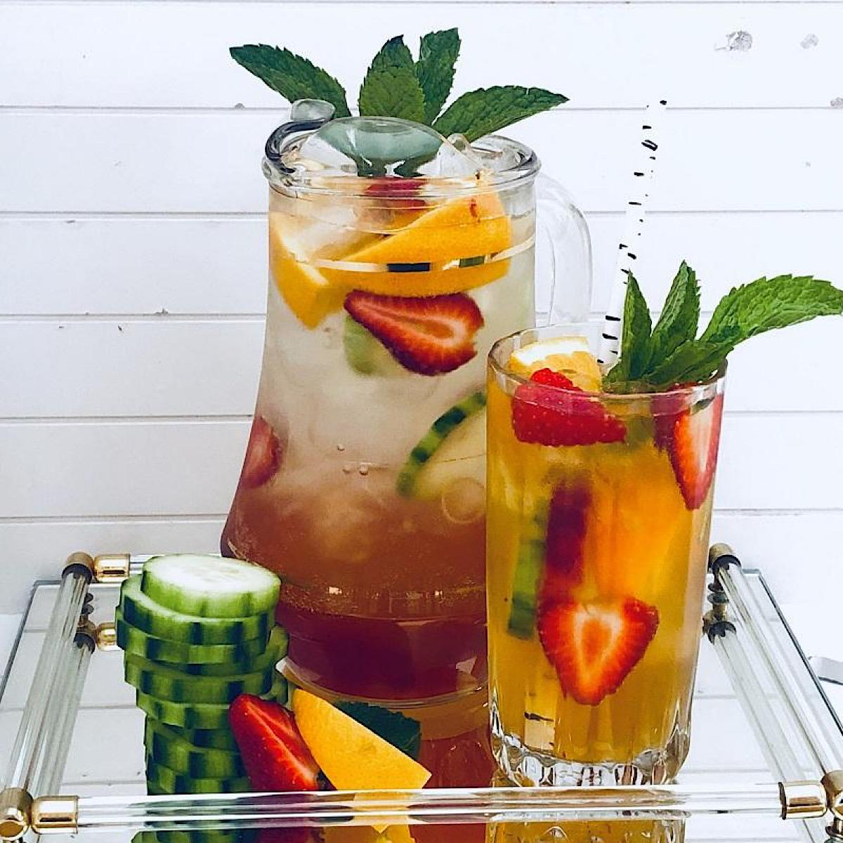 Pitcher of Sangria with cucumbers and Pimms Cup