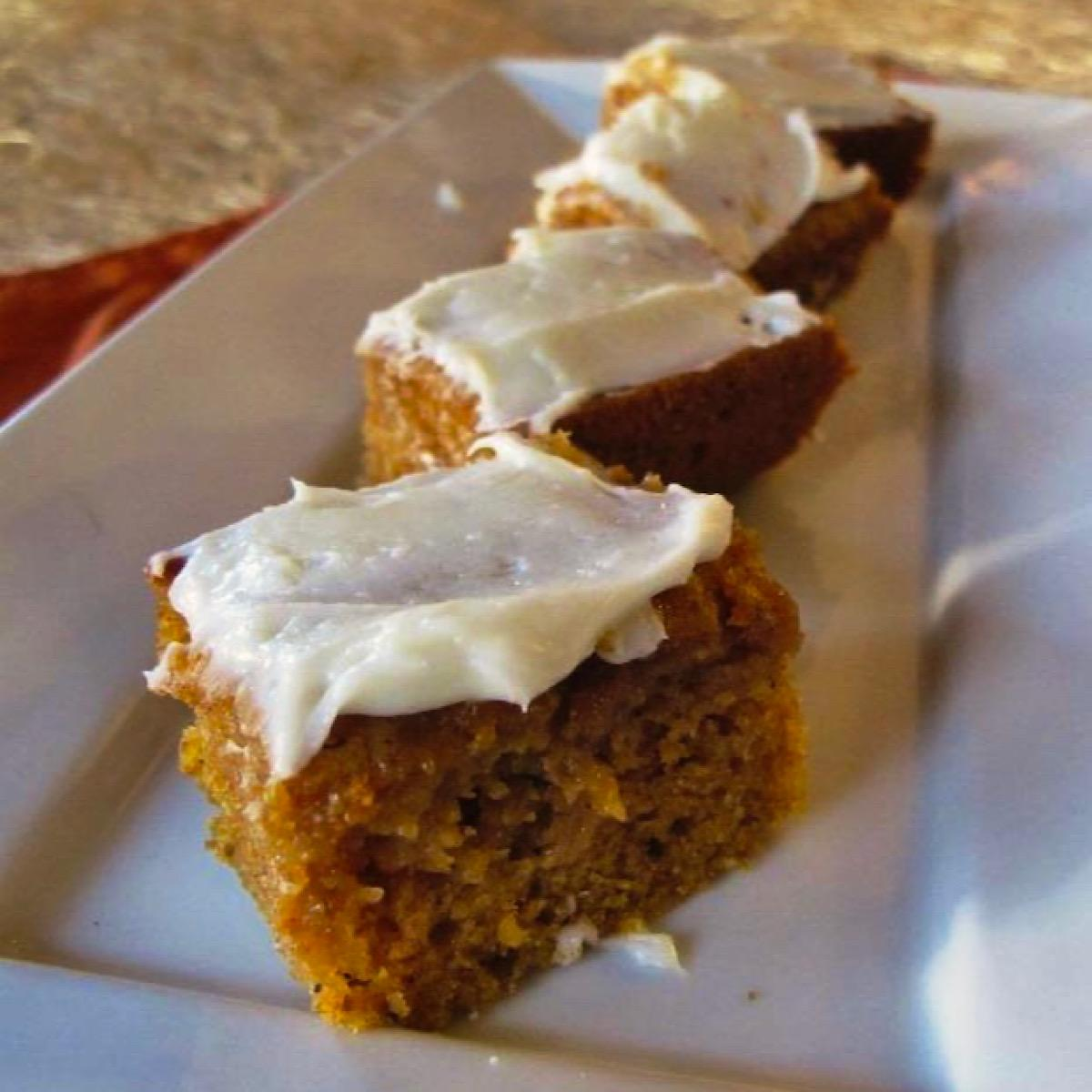 3 pumpkin bars with cream cheese frosting