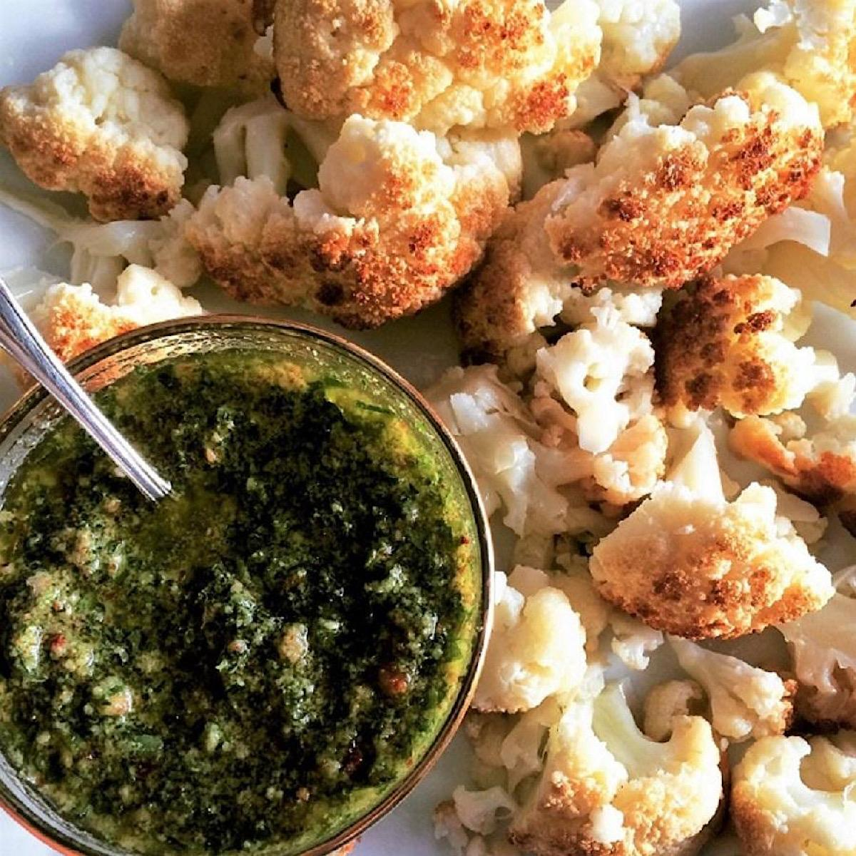 Chimichurri sauce with roasted cauliflower together on a dish