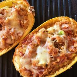 Low Carb spaghetti squash, chicken and enchilada sauce served in a spaghetti squash shell
