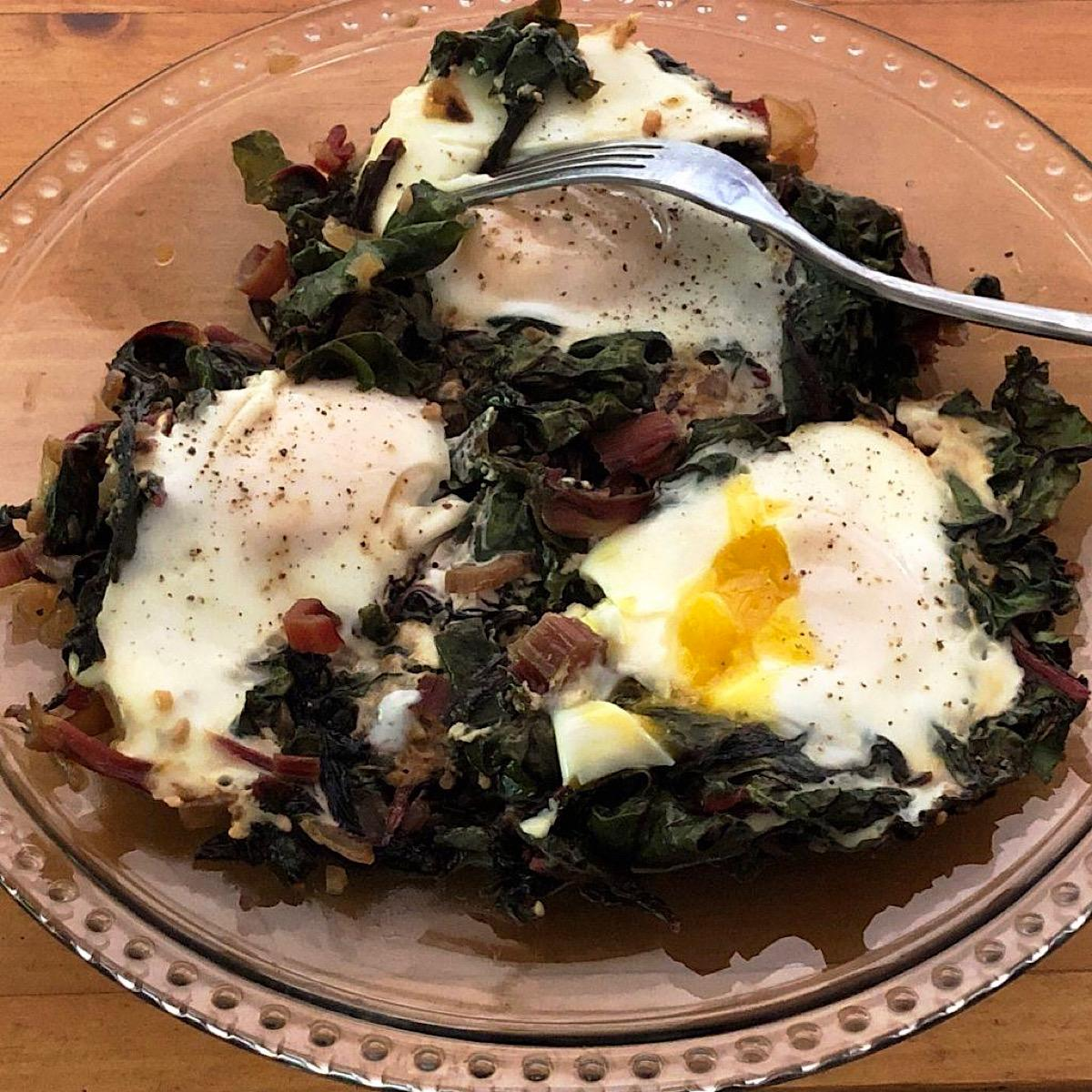Swiss chard with nested eggs