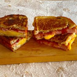 Taste test of 2 grilled cheese with tomato jam; one with velveeta and white bread & one with gouda and bakery grain bread