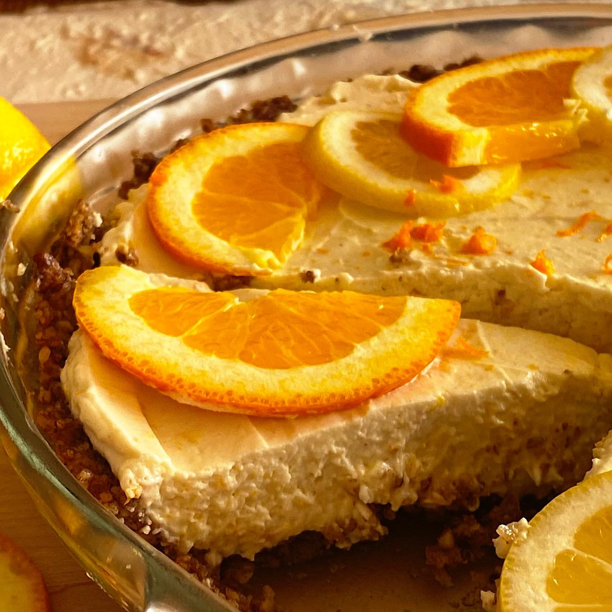 Close up of a piece of low carb lemon orange pie with a nut crust