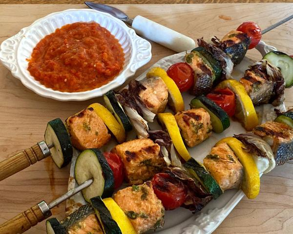 Salmon and vegetable kebabs with ajvar dipping sauce