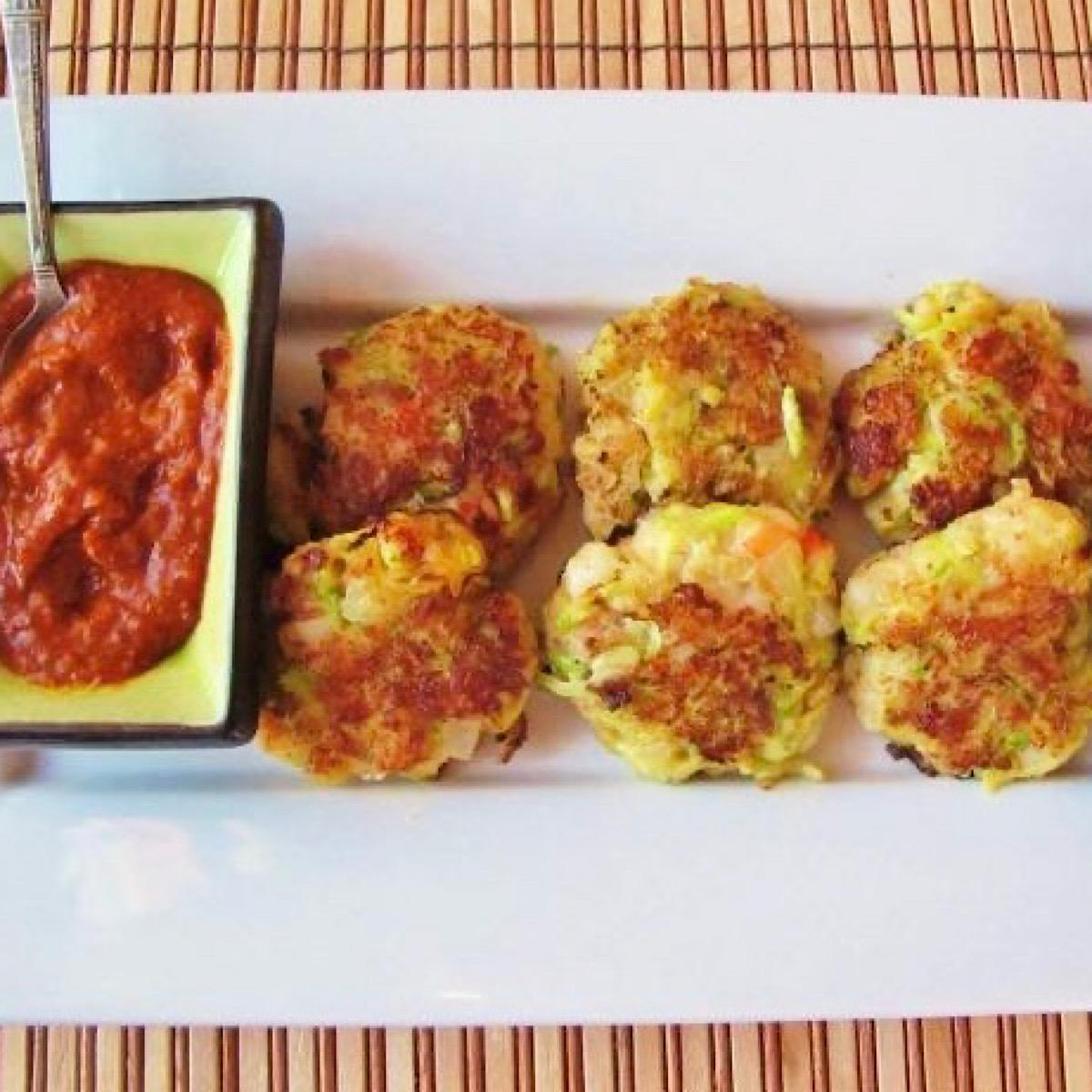 Zucchini fritters with harissa sauce on the side
