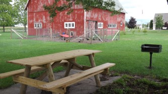 My husband made this picnic table earlier this summer and we have enjoyed using it and the grill he put in.