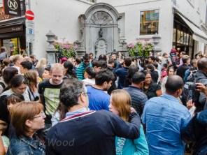 Crazy crowds surround this far-too-popular figure.