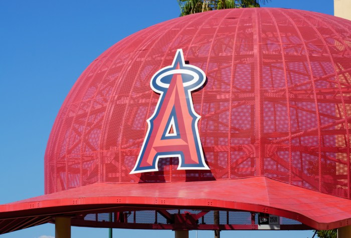 Iconic oversized Angels baseball cap at the entrance to Angel Stadium, home of Major League Baseball's Los Angeles Angels, by Ken Wolter / Shutterstock.com.