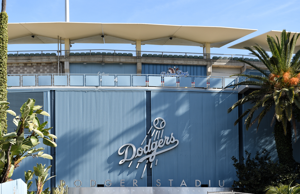 Closeup of Dodgers logo at Vin Scully Entrance to Dodger Stadium surrounded by palm trees