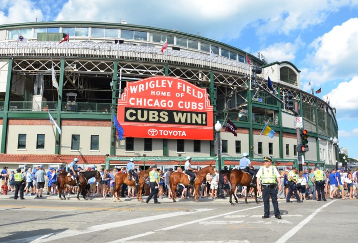 """Red Wrigley Field Marquee displaying """"CUBS WIN!"""""""