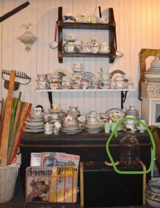 Picture of plate stash with glass jug circled