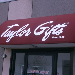 Taylor Gifts custom branded quarter barrel awning
