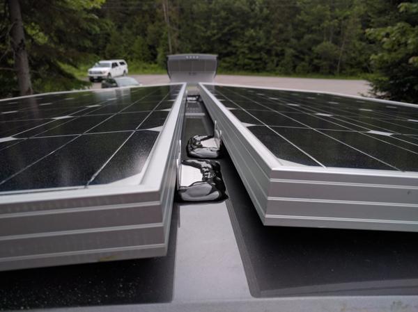 Solar Panels Installation, sealing the brackets