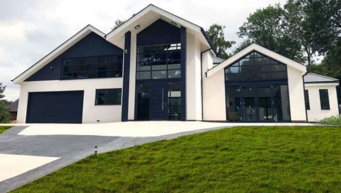 Modern house with resin driveway and decorative concrete edging in Kent