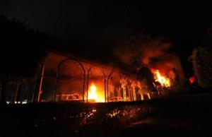 The U.S. Consulate in Benghazi is seen in flames during a protest by an armed group said to have been protesting a film being produced in the United States September 11, 2012. An American staff member of the U.S. consulate in the eastern Libyan city of Benghazi has died following fierce clashes at the compound, Libyan security sources said on Wednesday. Armed gunmen attacked the compound on Tuesday evening, clashing with Libyan security forces before the latter withdrew as they came under heavy fire. REUTERS/Esam Al-Fetori (LIBYA - Tags: POLITICS CIVIL UNREST)