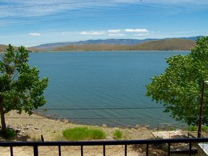 Topaz Lakefront Get-Away property also has a concrete boat house big enough for two boats, space for RV parking, and a small basketball court.