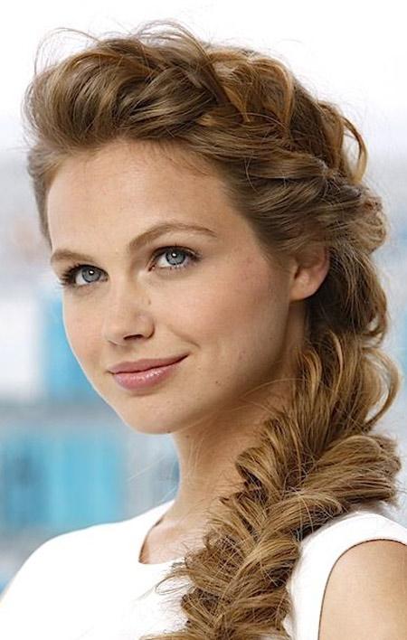 wedding hairstyle with a scythe photo 1