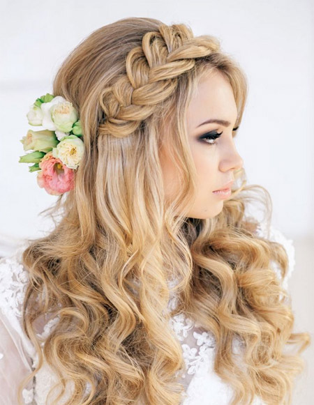 wedding hairstyle with a braid and flowers