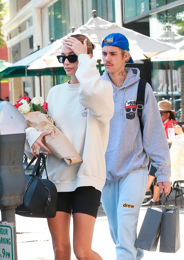 Hailey Baldwin with a bouquet of roses