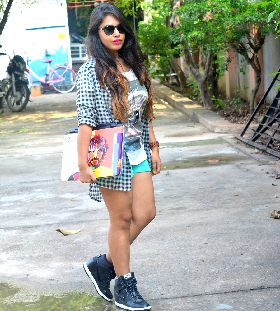 girl-in-plaid-shirt-shorts-with-sunglasses-and-nike-shoes