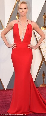 Charlize Theron in a gown by by Christian Dior