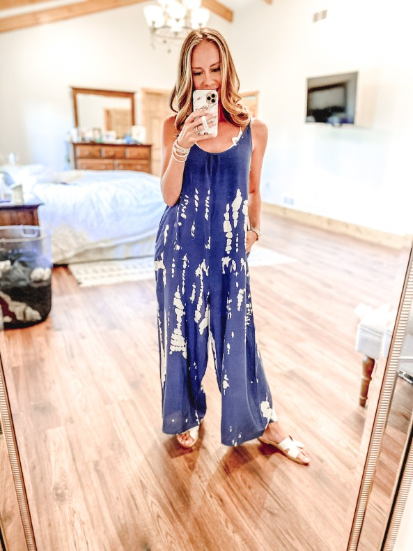 Top 7 Cute Spring Sandals for Women featured by top Pittsburgh fashion blogger, Fashionably Late Mom. Spring Sandals by popular Pittsburgh fashion blog, Fashionably Late Mom: image of a woman wearing a blue and white tie dye jumper and white slide sandals.
