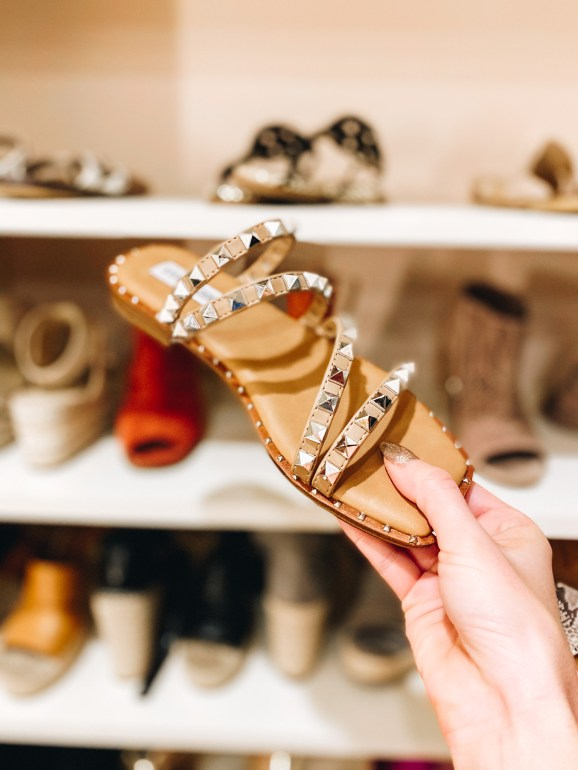 Top 7 Cute Spring Sandals for Women featured by top Pittsburgh fashion blogger, Fashionably Late Mom.  Spring Sandals by popular Pittsburgh fashion blog, Fashionably Late Mom: image of a woman holding a pair of studded sandals.