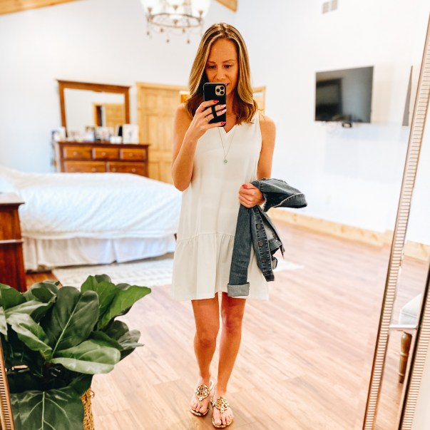 Top 7 Cute Spring Sandals for Women featured by top Pittsburgh fashion blogger, Fashionably Late Mom.  Spring Sandals by popular Pittsburgh fashion blog, Fashionably Late Mom: image of a woman wearing a white sleeveless dress and gold Tory Burch slide sandals.
