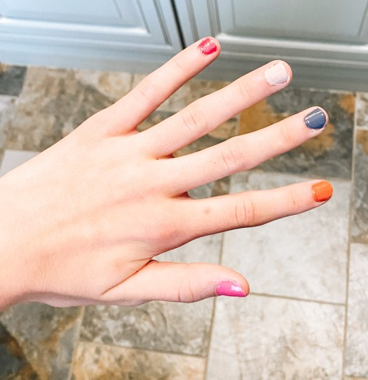 5 Hottest Summer Nail Polish Colors to Wear this Season featured by top Pittsburgh lifestyle blogger, Fashionably Late Mom |Summer Nail Polish by popular Pittsburgh beauty blog, Fashionably Late Mom: image of a woman's nails painted pink, orange, white, red, and blue.