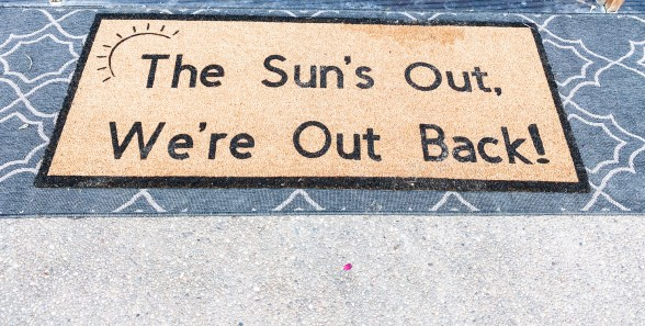 doormat, outdoor rug |  Summer Front Porch by popular Pittsburg life and style blog, Fashionably Late Mom: image of 'The Sun's Out We're Out Back' door mat.