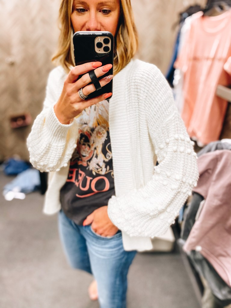 Nordstrom Anniversary Sale 2021: Try On Edition featured by top Pittsburgh fashion blogger, Fashionably Late Mom   Nordstrom Anniversary Sale by popular Pittsburgh fashion blog, Fashionably Late Mom: image of a woman wearing a Nordstrom tan knit sweater, Queen graphic t-shirt and light wash jeans.