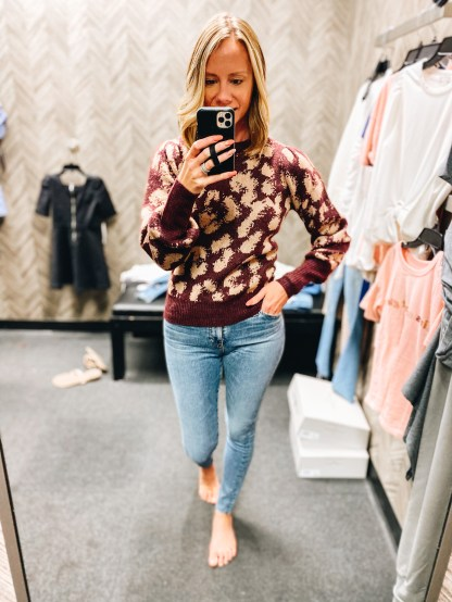 Nordstrom Anniversary Sale 2021: Try On Edition featured by top Pittsburgh fashion blogger, Fashionably Late Mom   Nordstrom Anniversary Sale by popular Pittsburgh fashion blog, Fashionably Late Mom: image of a woman wearing a Nordstrom maroon and tan leaopard print sweater and light wash jeans.