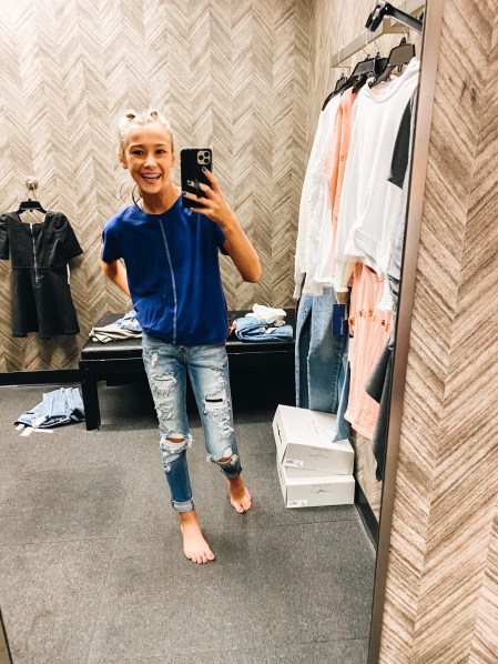 Nordstrom Anniversary Sale 2021: Try On Edition featured by top Pittsburgh fashion blogger, Fashionably Late Mom   Nordstrom Anniversary Sale by popular Pittsburgh fashion blog, Fashionably Late Mom: image of a teenage girl wearing a Nordstrom blue shirt and distressed jeans.