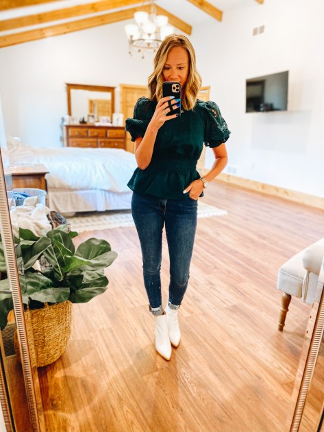 business casual outfits, peplum blouse, white booties | Working Mom Outfits by popular Pittsburgh fashion blog, Fashionably Late Mom: image of a woman wearing a dark green peplum top, jean, and white ankle boots.