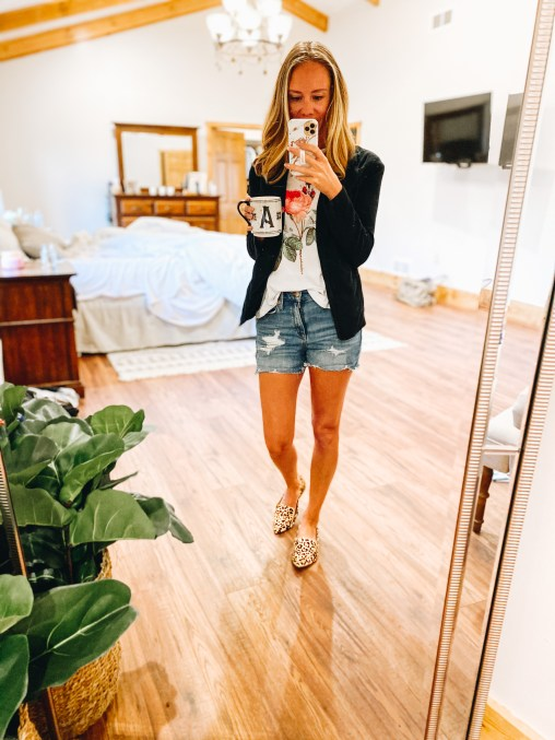 fashion for working moms, casual blazer, denim shorts, casual style   How to Style a Blazer by popular Pittsburgh fashion blog, Fashionably Late Mom: image of a woman wearing a floral graphic print t-shirt, black blazer, distressed denim shorts, and leopard print flats.